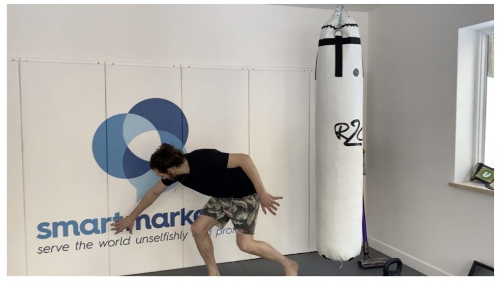 Ezra showing off the Smart Marketer logo on the wall pads.